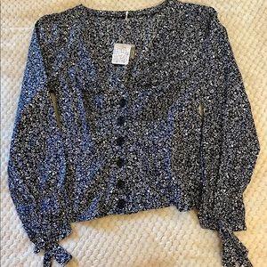 Black floral blouse.